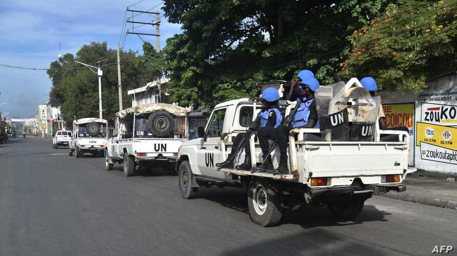 Members of United Nations Mission for Justice Support in Haiti patrol the streets of Port-au-Prince, on Nov. 21, 2018, during the third day of strikes.