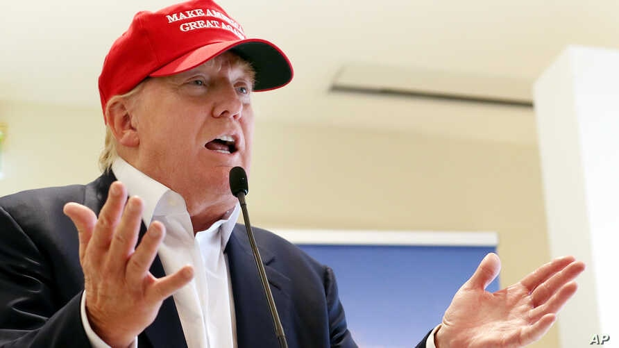 Donald Trump speaks to the media during a press conference on the 1st first day of the Women's British Open golf championship on the Turnberry golf course in Turnberry, Scotland, Thursday, July 30, 2015.