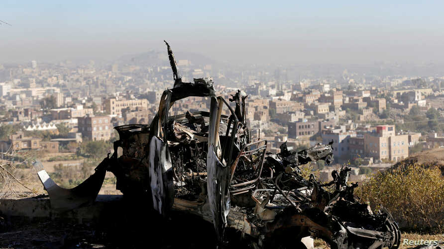 The wreckage of a vehicle is pictured at the site of air strikes in Sanaa, Yemen Dec. 26, 2017.