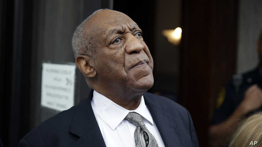 FILE - Bill Cosby exits the Montgomery County Courthouse after a mistrial was declared in Norristown, Pennsylvania, June 17, 2017.