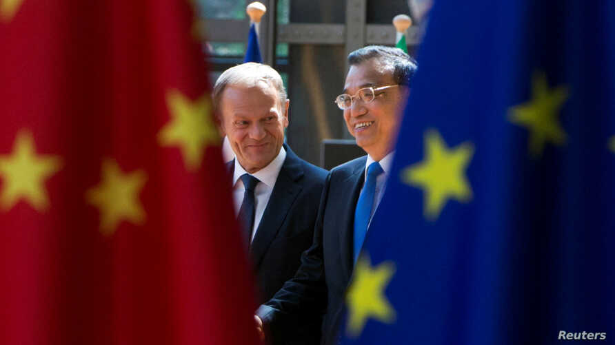 FILE - European Council President Donald Tusk and Chinese Premier Li Keqiang arrive to attend an EU-China Summit in Brussels, Belgium, June 2, 2017.