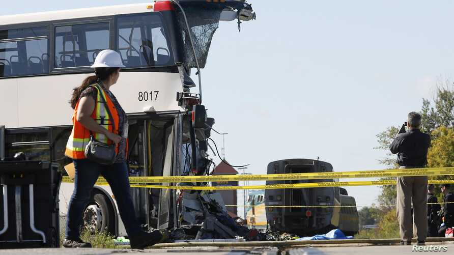 Official takes pictures at scene of accident involving a bus and a train, Ottawa, Sept. 18, 2013.