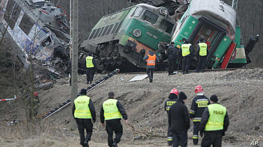 Rescuers work at the site where two trains collided in Szczekociny, southern Poland, Sunday, March 4, 2012.