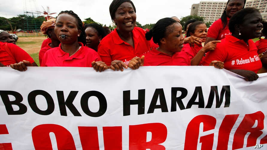 Women sing slogans during a demonstration calling on the government to rescue the kidnapped girls of the government secondary school in Chibok. Abuja, Nigeria, May 28, 2014.