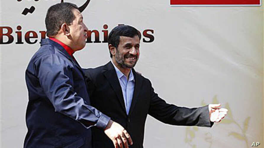 Iranian President Mahmoud Ahmadinejad, center, welcomes his Venezuelan counterpart Hugo Chavez, during an official welcoming ceremony, in Tehran, Iran, 19 Oct 2010