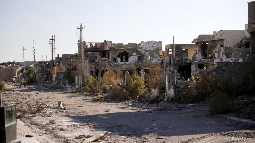 Destroyed buildings are seen in the city of Ramadi, January 16, 2016. Baghdad and Washington have touted Ramadi as the first major success for Iraq's U.S.-backed army since it collapsed in the face of Islamic State's lightning advance across the coun