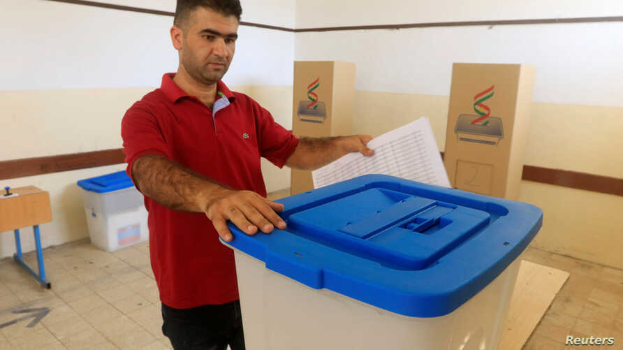 A kurdish employee prepares the ballot boxes for the September 25th independence referendum in Erbil, Iraq  Sept. 24, 2017.