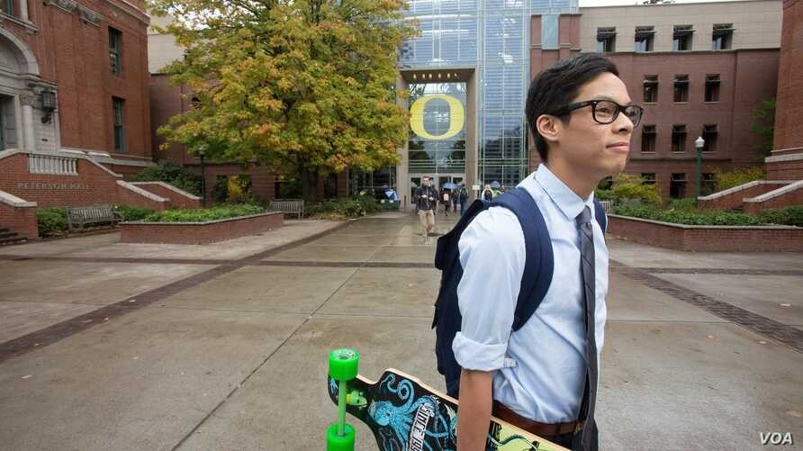 A student walks across campus at the University of Oregon in Eugene, Oregon.