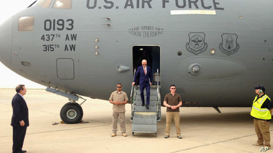 Vice President Joe Biden steps off a C-17 military transport plane upon his arrival in Baghdad, Iraq, April 28, 2016.