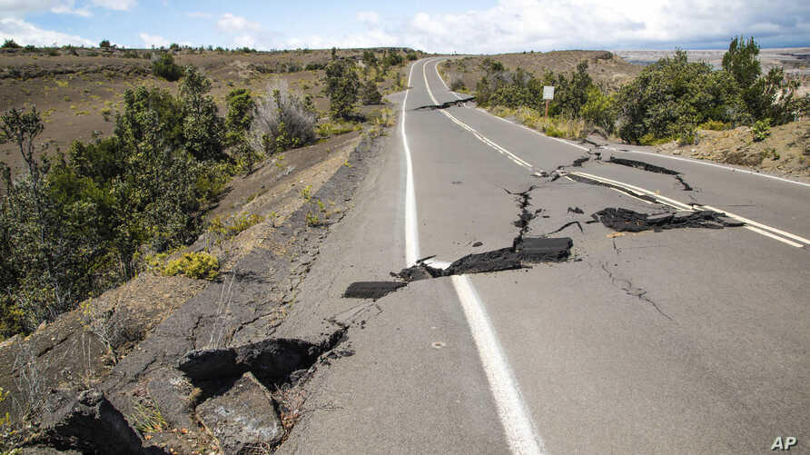 This photo provided by the National Park Service shows earthquake damage to Crater Rim Drive inside Hawaii Volcanoes National Park in Hawaii, Aug. 17, 2018.