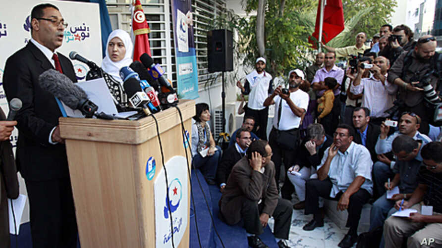 Campaign manager of the Ennahda party, Abdelhamid Jlazzi (L) Campaign manager of the Ennahda party, Abdelhamid Jlazzi (L) speaks outside the party's headquarters in Tunis. Moderate Islamists claimed victory on Monday in Tunisia's first democratic ele