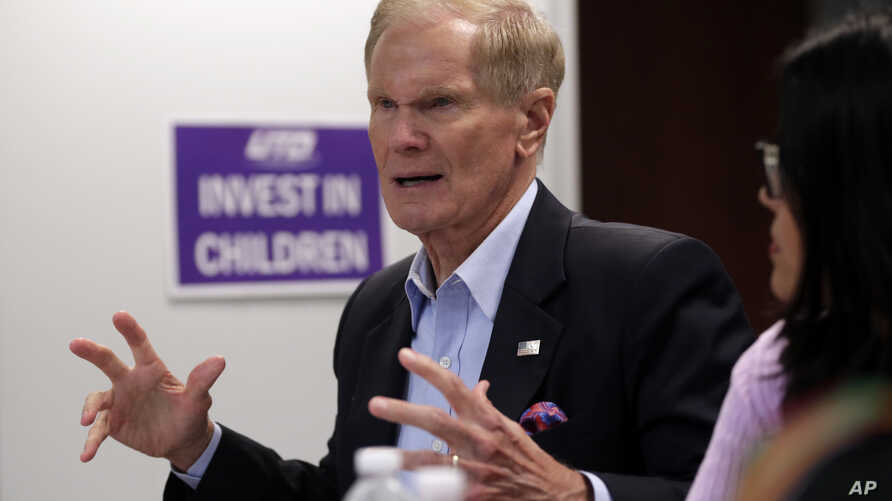 FILE - Sen. Bill Nelson, D-Fla., speaks during a roundtable discussion in Miami, Aug. 6, 2018. Nelson has told the Tampa Bay Times that  Russian operatives have penetrated some of his state's election systems ahead of this year's midterms. But Florid