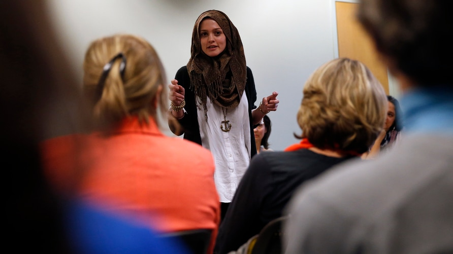 Syrian-American poet Amal Kassir recites her work during a gathering where immigrants from hostile environments spoke about their lives, at the YWCA in Boulder, Colorado, April 19, 2016.