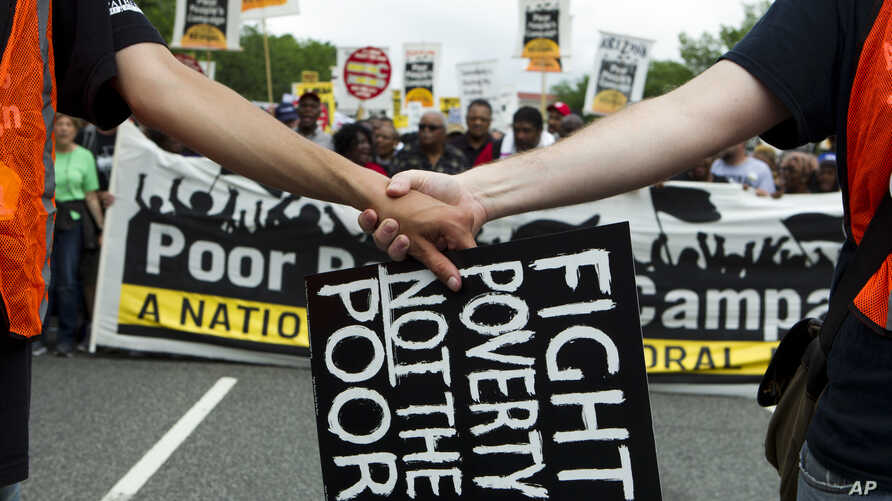 FILE - Demonstrators march outside the U.S. Capitol during the Poor People's Campaign rally at the National Mall in Washington, June 23, 2018.