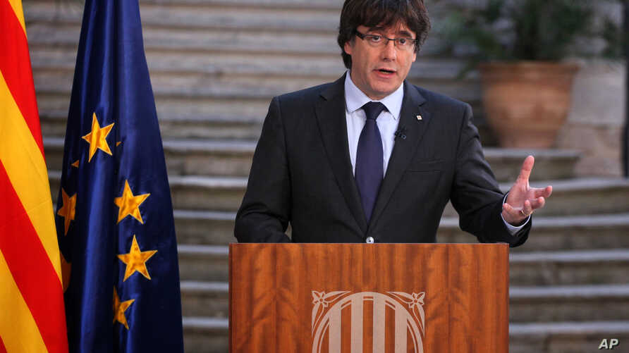 Catalan President Carles Puigdemont speaks during a statement at the Palau Generalitat in Barcelona, Spain, on Saturday, Oct. 28, 2017.