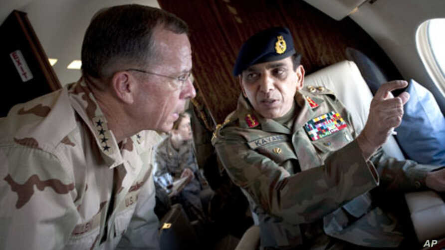 Gen. Ashfaq Parvez Kayani, Pakistani chief of Army Staff points out a feature to Navy Adm. Mike Mullen, chairman of the Joint Chiefs of Staff during an aerial tour of Northern Pakistan, 24 Jul 2010