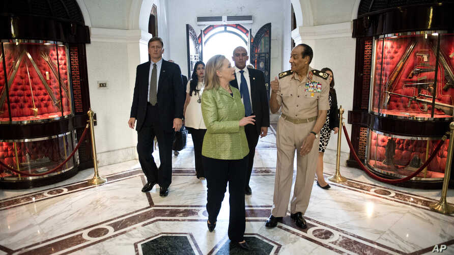 Field Marshal Hussein Tantawi walks with U.S. Secretary of State Hillary Clinton at the Ministry of Defense in Cairo, Egypt, July 15, 2012.