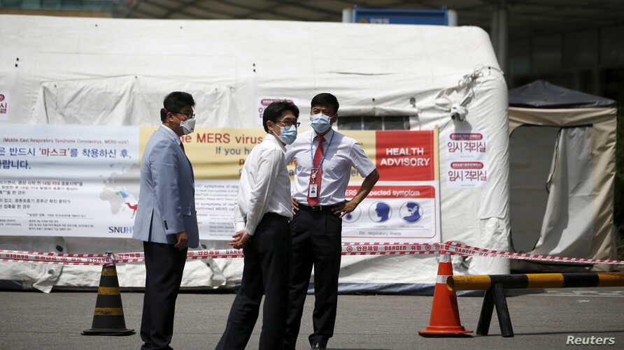 Hospital workers stand in front of a quarantine area set up at a hospital in Seoul, South Korea, June 2, 2015.