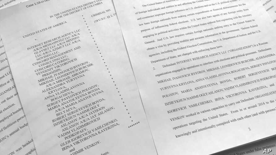 A portion of the Feb. 16, indictment against Russia's Internet Research Agency is photographed in Washington, March 15, 2018.