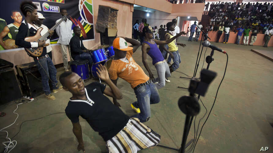 FILE - Youths dance in the a rap band entertaining meeting of the National Youth Council, Jan. 4, 2013.