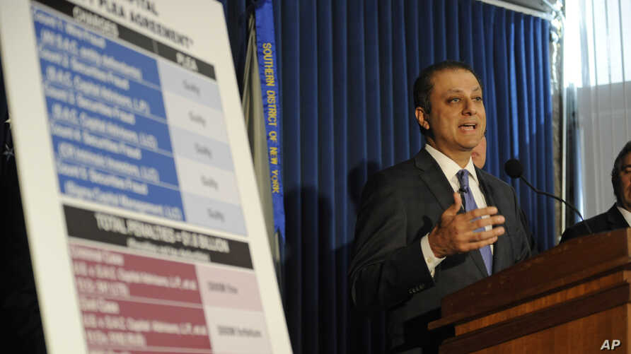 U.S. Attorney Preet Bharara speaks at a press conference, Nov. 4, 2013, in New York. Federal prosecutors say hedge fund giant SAC Capital Advisors has agreed to plead guilty to fraud charges and to pay a $1.8 billion financial penalty.