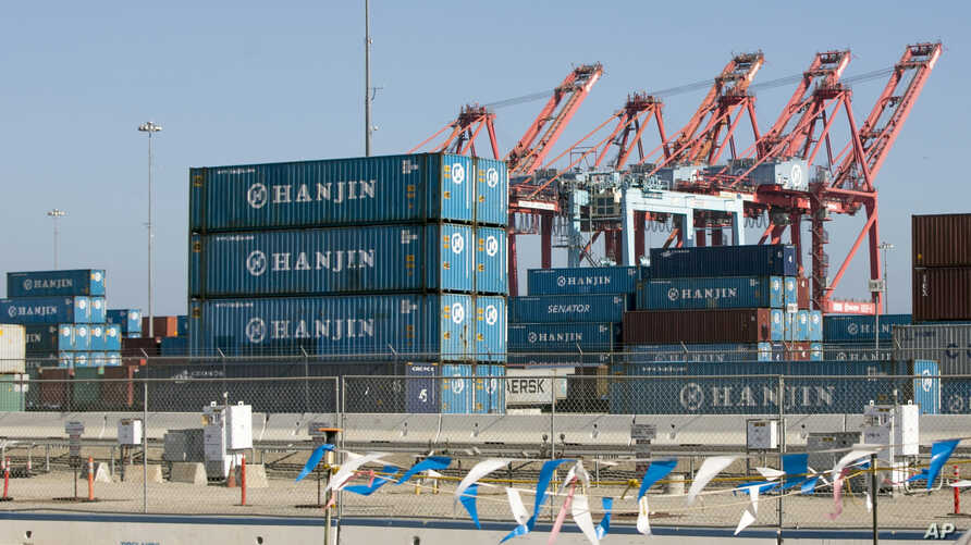 FILE - South Korea's Hanjin Shipping Co. containers are seen in the Port of Long Beach, Calif.,Sept. 1, 2016.
