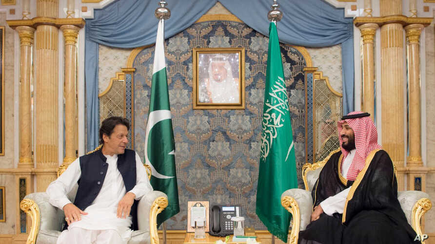 In this photo released by the state-run Saudi Press Agency, Pakistani Prime Minister Imran Khan, left, meets Saudi Crown Prince Mohammed bin Salman, Sept. 19, 2018, in Jiddah, Saudi Arabia.