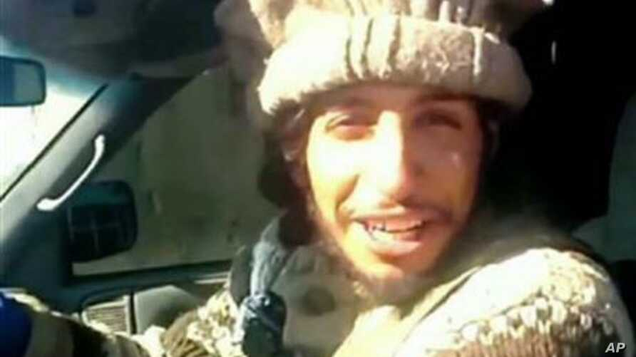 This undated image taken from a Militant Website shows Belgian Abdelhamid Abaaoud. A French official said Abaaoud is the suspected mastermind of the Paris attacks was also linked to thwarted train and church attacks.