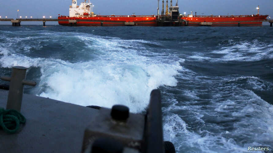 FILE PHOTO: An oil tanker is docked while oil is pumped into it at the ships terminal of PDVSA's Jose Antonio Anzoategui industrial complex in the state of Anzoategui April 15, 2015.
