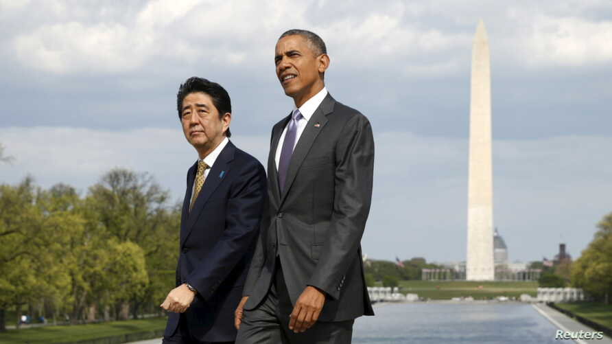 U.S. President Barack Obama and Japanese Prime Minister Shinzo Abe visit the Lincoln Memorial in Washington, with Washington Monument in the background April 27, 2015.