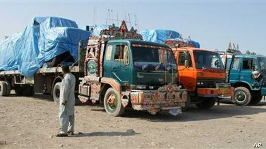 Afghanistan-bound NATO trucks are parked at a roadside as authorities blocked NATO supply line to Afghanistan after NATO allegedly killed three border guards at Pakistani border, at tribal check post of Takhta Beg in Khyber area of Pakistan near Pak-
