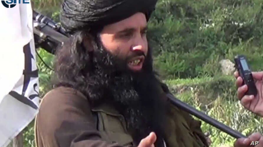FILE - This undated image provided the SITE Intel Group, an American private terrorist threat analysis company, Mullah Fazlullah in Pakistan.