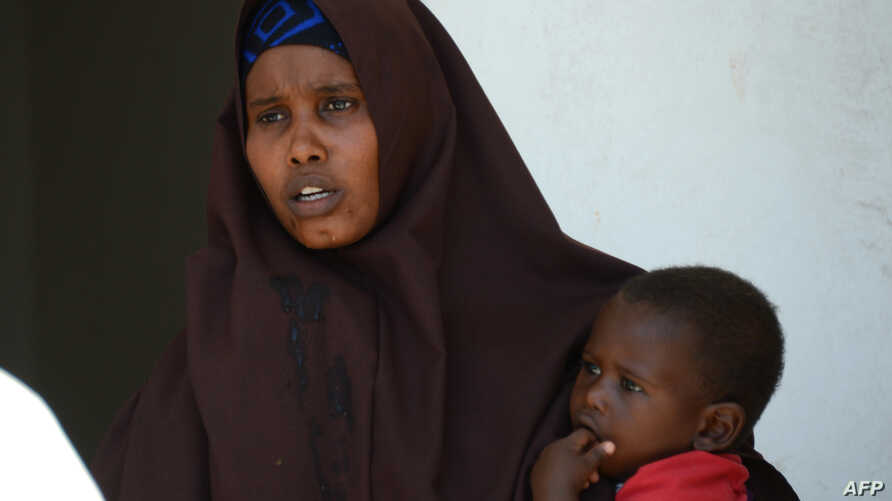 Lul Ali Osman, who claimes she was raped by security forces, is seen holding her child at the court house in Mogadishu March 3, 2013.