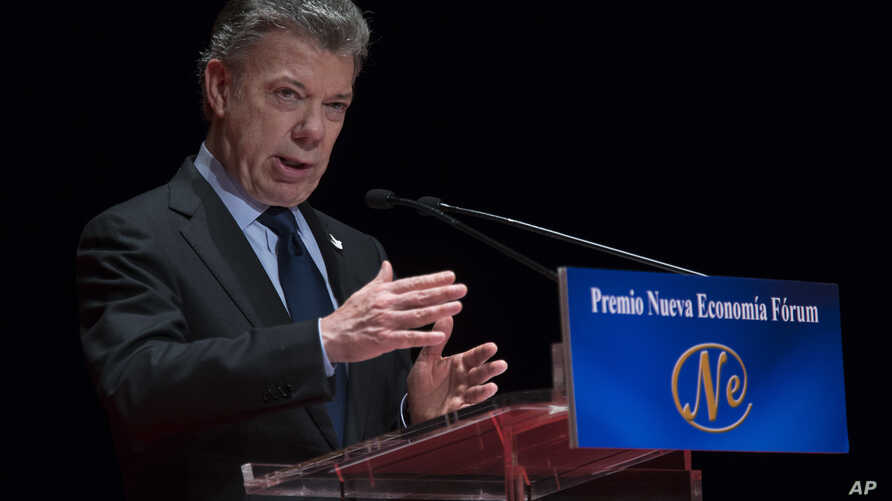 Nobel Peace Prize laureate and Colombia's President, Juan Manuel Santos, gives a speech after receiving the Nueva Economia Forum award at the Royal theatre in Madrid, Dec. 14, 2016.