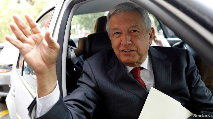 Andres Manuel Lopez Obrador, presidential pre-candidate of the National Regeneration Movement (MORENA), waves as he leaves an event during which he unveiled his anti-corruption plan he will put in place if he wins this year's election, in Mexico City