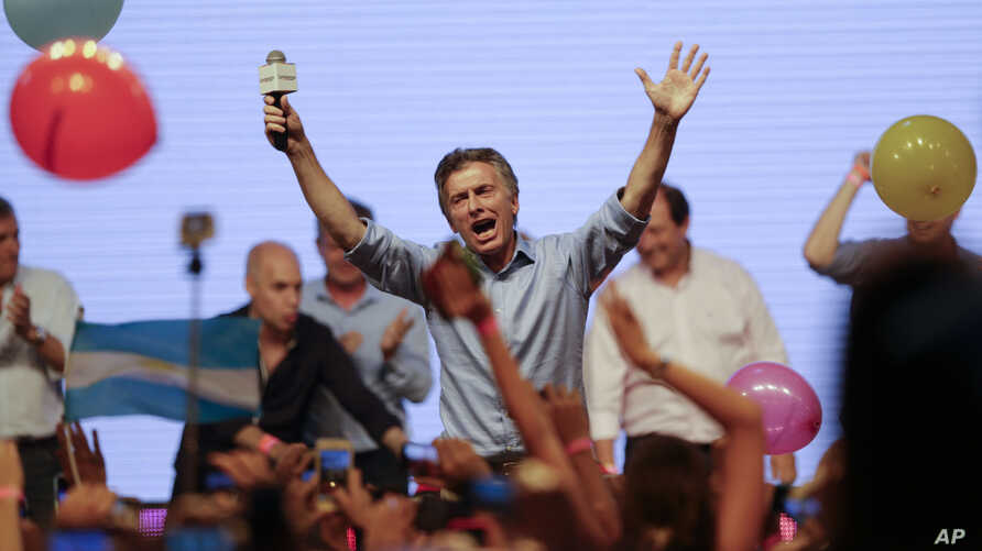 Opposition presidential candidate Mauricio Macri celebrates his victory with supporters at his campaign headquarters in Buenos Aires, Argentina, Nov. 22, 2015