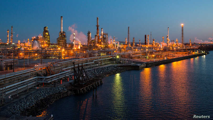 FILE - The Philadelphia Energy Solutions oil refinery owned by The Carlyle Group is seen at sunset in Philadelphia, March 26, 2014. The refinery's bankruptcy has prompted a new look at biofuels policy.