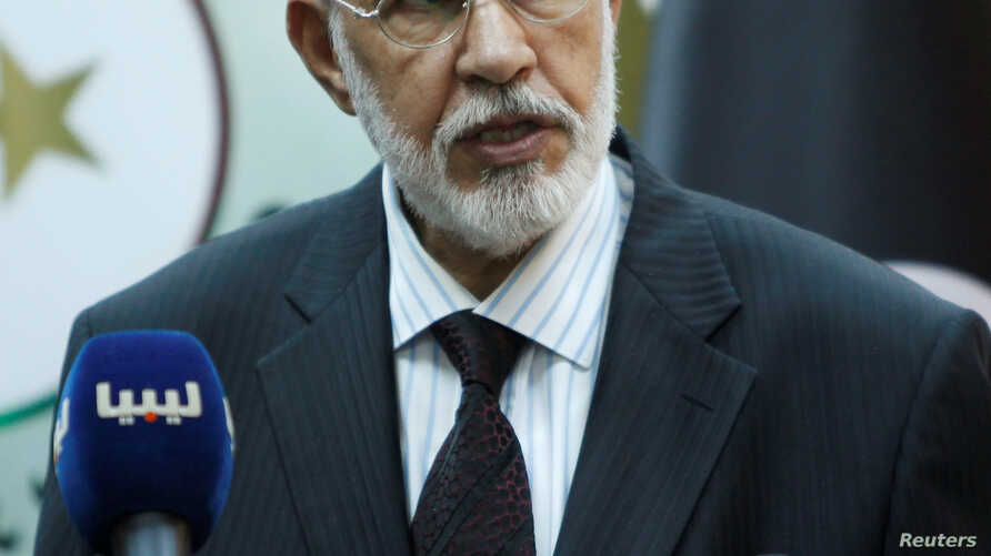 "FILE - Mohammed Siyala, foreign minister in Libya's U.N.-backed national unity government, speaks during a news conference in Tripoli, May 30, 2016. Siyala called U.S. President Donald Trump's travel ban an ""unjust decision"" that should be reviewed."
