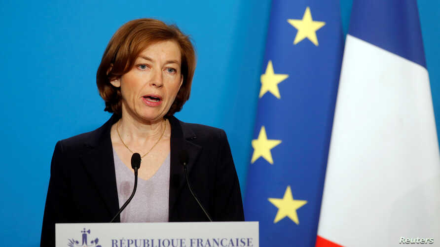 FILE - French Minister of the Armed Forces Florence Parly makes an official statement in the press room at the Elysee Palace, in Paris, France, April 14, 2018.