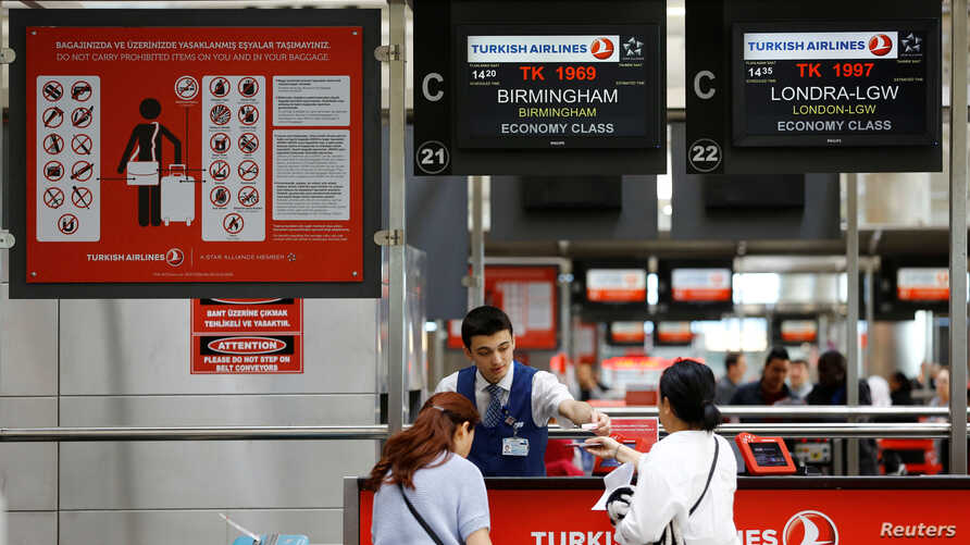 Passengers check-in for UK bound flights at a Turkish Airlines counter at Ataturk International airport in Istanbul, Turkey, March 24, 2017.