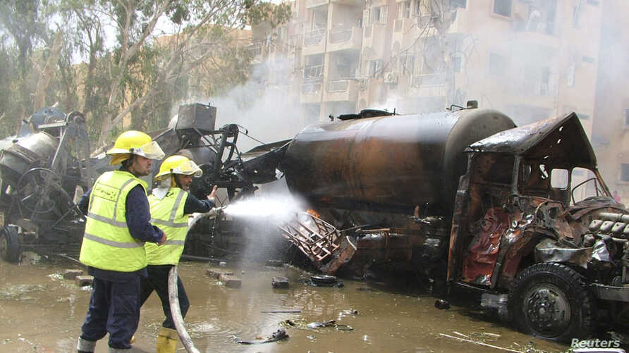 Syrian firefighters work at the site of an explosion in Deir el-Zour, in this handout released by Syria's national news agency SANA, May 19, 2012.