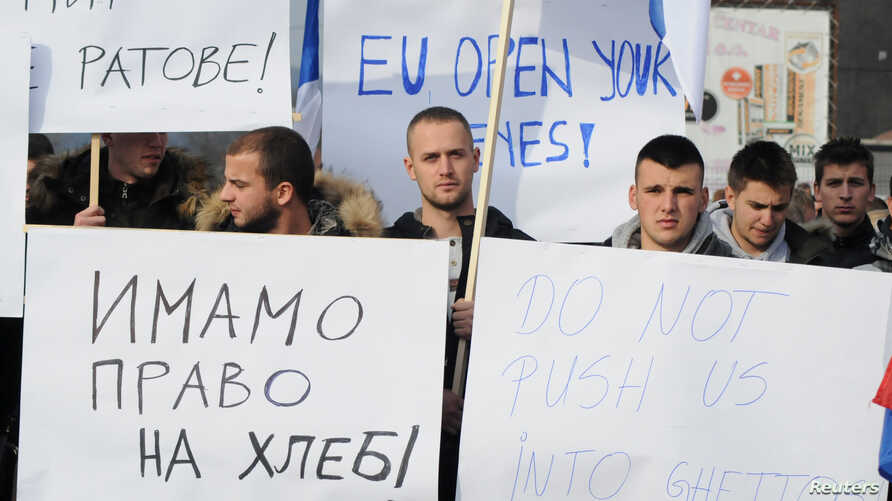 FILE - People protest after Kosovo's decision to raise tariffs on Serbian and Bosnian goods, in the village of Rudare near Mitrovica, Kosovo, Nov. 23, 2018.