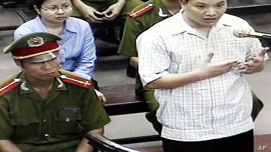 "FILE - Nguyen Van Dai, right, testifies in this May 2013 file photo, originally taken from TV footage. The well-known Vietnamese human rights lawyer was arrested Wednesday on anti-state ""propaganda"" charges."
