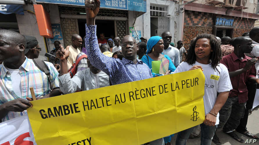 Protesters gather outside the Gambian embassy in Senegal to demand President Yahya Jammeh halt the mass execution of prisonersö  on August 30, 2012.