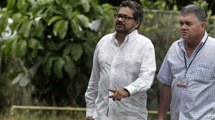 Ivan Marquez, chief negotiator for the Revolutionary Armed Forces of Colombia (FARC), center, accompanied by a security officer, arrives for a news conference at the close of the 19th round of peace talks with Colombia's government in Havana, Cuba, F