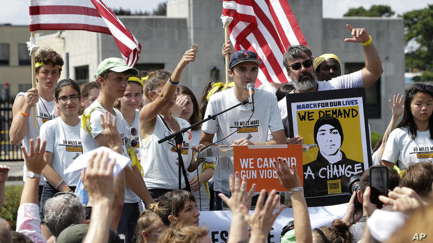 David Hogg (C) a survivor of the school shooting at Marjory Stoneman Douglas High School, in Parkland, Florida, addresses a rally in front of the headquarters of gun manufacturer Smith & Wesson, Aug. 26, 2018, in Springfield, Mass.