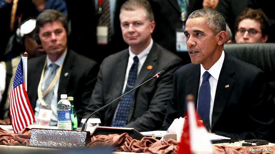 U.S. President Barack Obama, right, delivers remarks at the US-ASEAN meeting at the ASEAN Summit in Kuala Lumpur, Malaysia, Nov. 21, 2015.