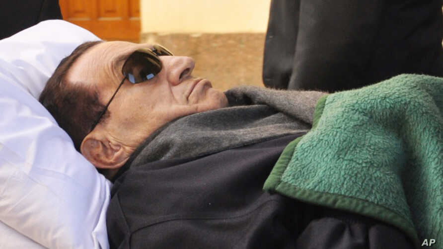 Former Egyptian president Hosni Mubarak is wheeled into a court house in Cairo, Egypt, Jan. 9, 2012.