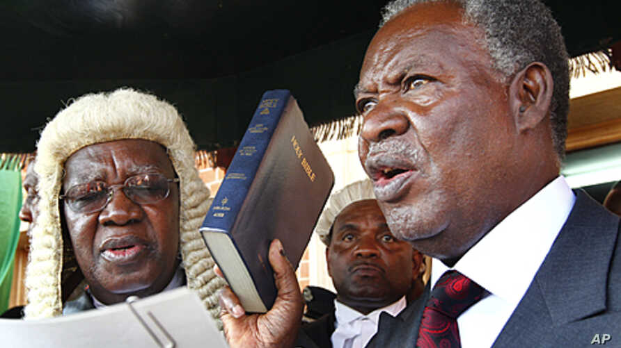 Zambia's new President Michael Sata, right, takes the oath of office on the steps of the supreme court in Lusaka, September 23, 2011.