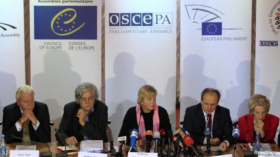 Members of the Parliamentary Assembly of the Organisation for Security and Cooperation in Europe (OSCE), led by vice-president of the Organization Walburga Habsburg Douglas (C), attend a news conference in Kiev, October 29, 2012.